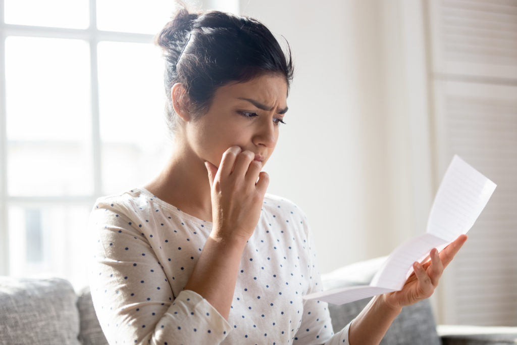 Anxious young woman get unpleasant news in letter