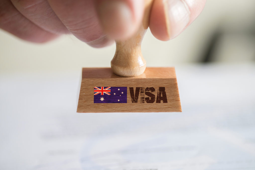 A stamp with the Australian flag on it showing the words VISA